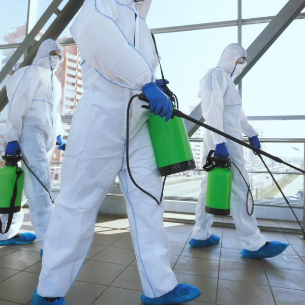 men-in-respirators-and-protective-suits-cleaning-p-RUFCBNG_